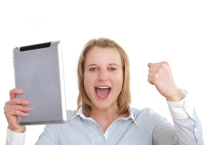 Young business woman with a tablet pc in the hand cheering with her clenched fist photo