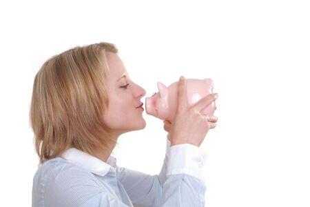 Young woman kissing a big piggy bank photo