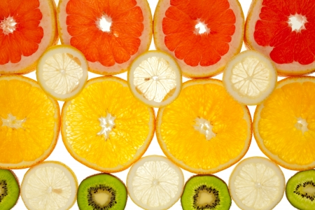 Background of kiwi, grapefruit, orange and lemon disks