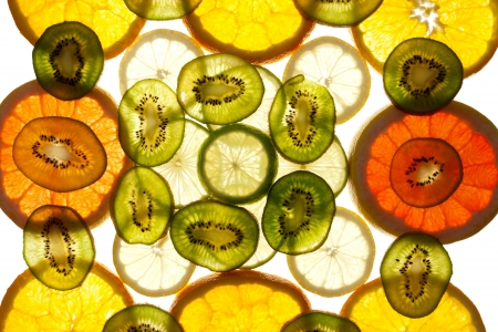 Colorful background of different fruit slices Stock Photo - 13659644