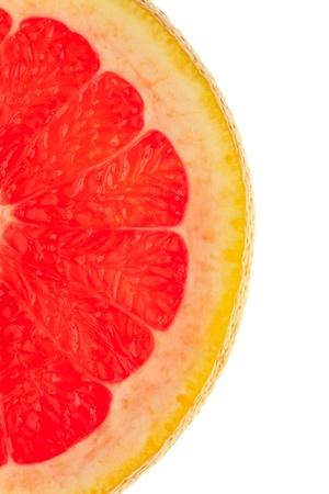 Macro shot of a half slice of grapefruit on white background