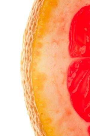 quarter slice of grapefruit on white background