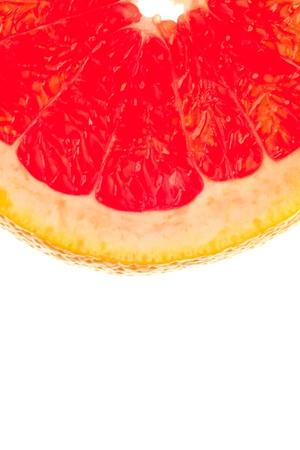 Macro shot of a quarter slice of grapefruit on white background