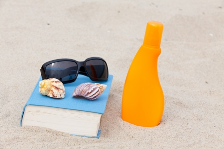 Read on the beach and enjoy the sun Stock Photo - 13967614