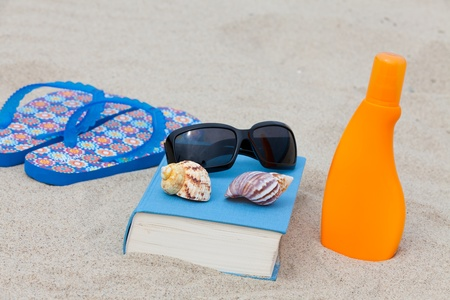 Enjoy with a good book the sun on the beach Stock Photo - 13967646
