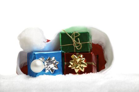 Three little Christmas packages in a Santa Claus cap photo