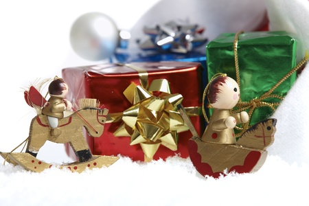 Small Christmas packages and wooden Christmas tree decorations photo