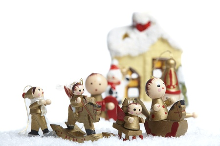 small wooden christmas tree decorations figures stand in the snow stock photo 14331836