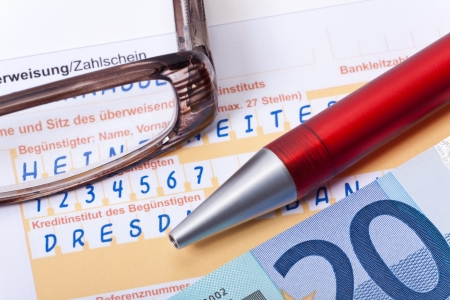 Payment form with banknote, a pen and a glasess on white background photo