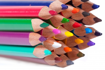 Colorful pencils close up macro shot isolated on white background photo