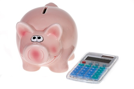 Smiling Pink piggy bank and a modern pocket calculator isolated on white background photo