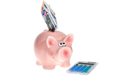 Smiling Pink piggy bank with Euro bank notes and a modern pocket calculator isolated on white background photo