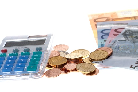 Pocket calculator and Euro Banknotes and coins isolated on white background photo