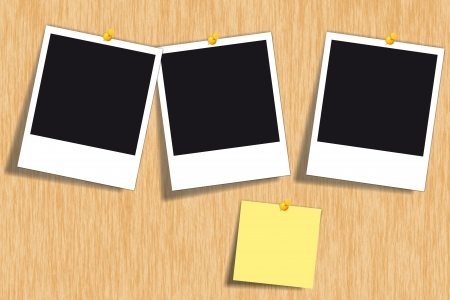 Wooden bulletin board with blank photo cards and a yellow note paper Stock Photo - 15027612