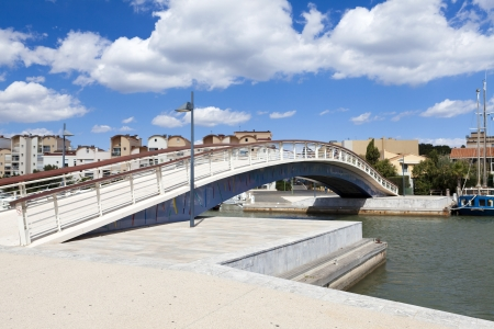 Footbridge over the harbor basin in the Marina of Gruissan in south france Stock Photo - 15964993