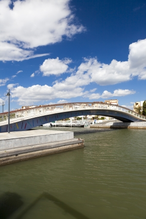 Footbridge over the harbor basin in the Marina of Gruissan in south france Stock Photo - 15964819