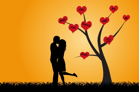 Kissing couple are standing under a tree with red hearts which words of love as silhouette Stock Photo - 17132520