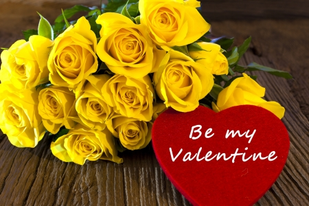 Yellow roses with a big red heart of felt with the words  Be my Valentine  photo