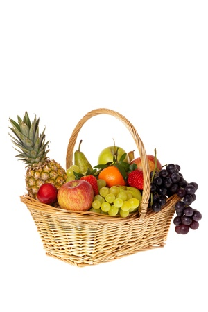Fresh fruits in wicker basket isolated front of white background photo