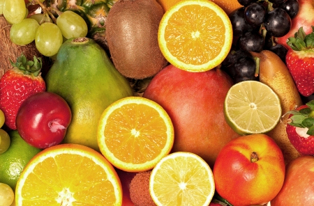 Background from many different exotic fruits photo