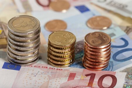 retained: Background of Euro coins and bills