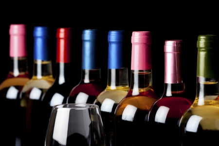 Some wine bottles and a wineglass isolated on black background Stock Photo
