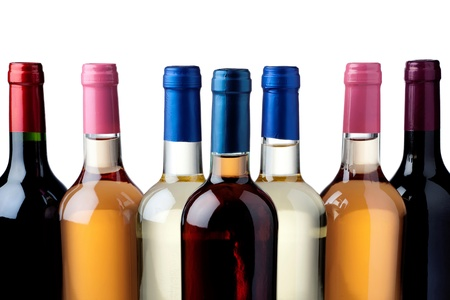 Some wine bottles in front of white background