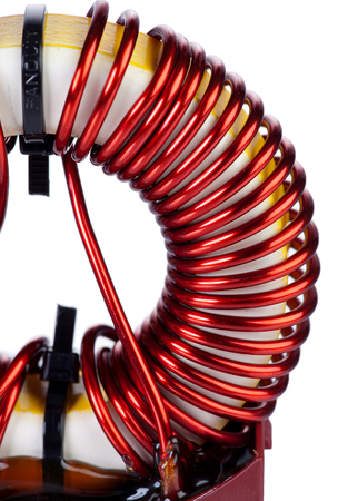 choke: Detail Close-up View of a Industrial Toroidal Choke Coil isolated on White Background Stock Photo