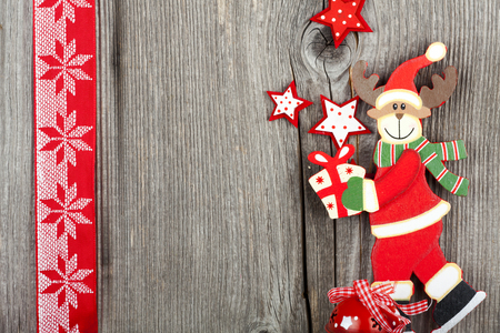 Christmas Greeting Card with a wooden Reindeer Shape and Copy Space on old wooden Board Stock Photo - 23483217