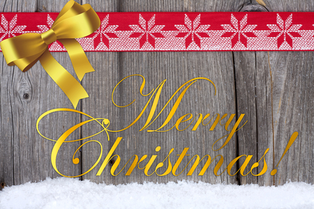 Christmas Greetings on Wooden Board with golden Bow and red-white Fabric Ribbon Stock Photo - 23483224