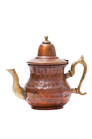 Old arab copper tea pot isolated on white Background photo