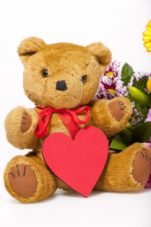 valentine s day teddy bear: Small teddy bear with a red heart isolated in front of white Hintergrud Stock Photo