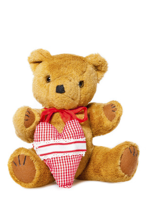 valentine s day teddy bear: Plush Teddy with fabric heart isolated on white Background