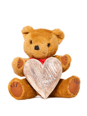 valentine s day teddy bear: Stuffed animal teddy with a heart of wood isolated on white with Copy Space on the Heart