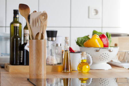 View of a kitchen worktop with induction hob and other kitchen utensils with copy space on the right side of the image Stock Photo