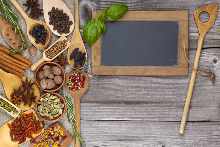 Herbs and spices on rustic wooden background Standard-Bild