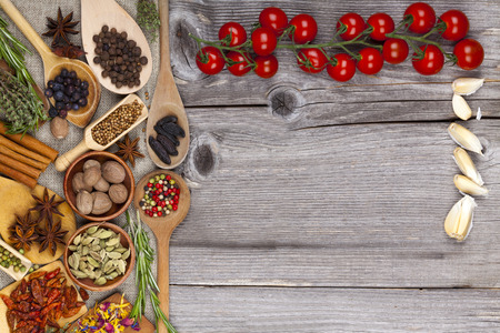 Wood background in country style with spices photo