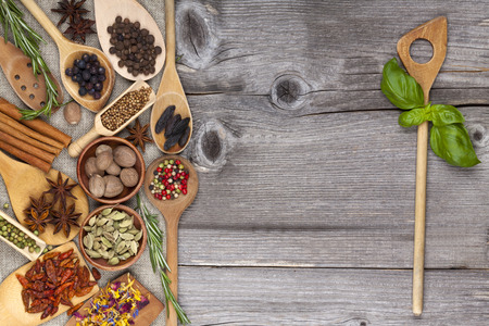 Herbs and spices on old wooden Background photo