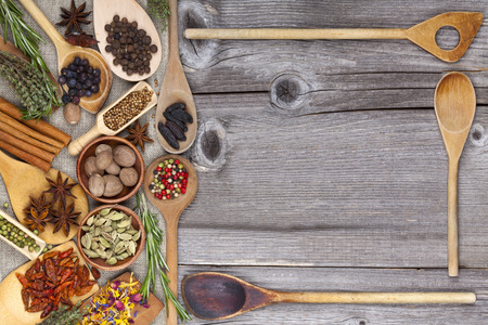 Fresh Spices and Herbs with wooden Spoons photo