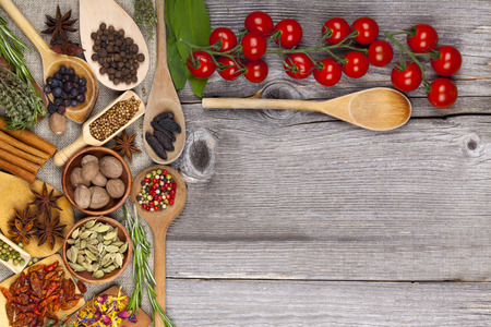 Herbs and spices on wooden background photo