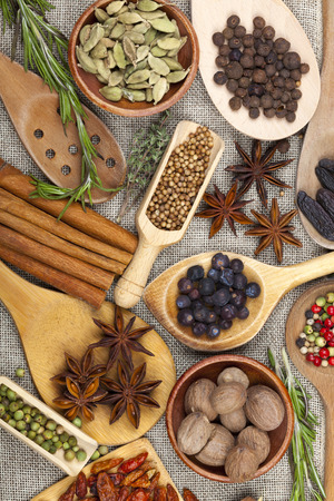 Many fragrant spices in bowls and scoops photo