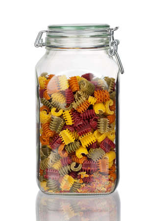 Storage jar with colorful Pasta Noodles with real reflection isolated on white Background photo