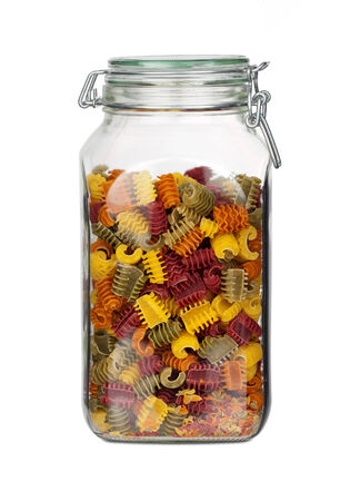 Storage jar with colorful Pasta Noodles isolated on white Background photo