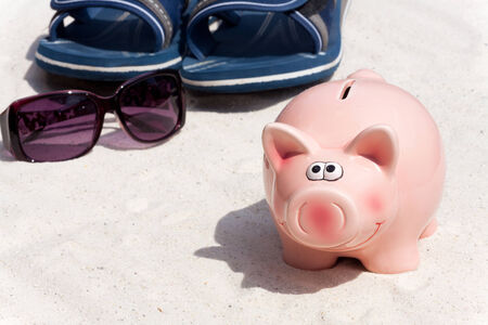 holiday budget: Piggy bank and beach accessories, saving for the the holiday