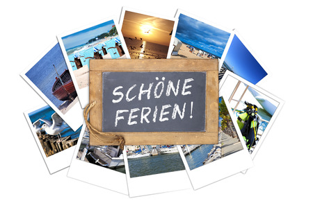 ferien: Old slate blackboard with the text message in germans words  SCHOENE FERIEN lies on a stack of many Vacations instant pictures isolated on white Background