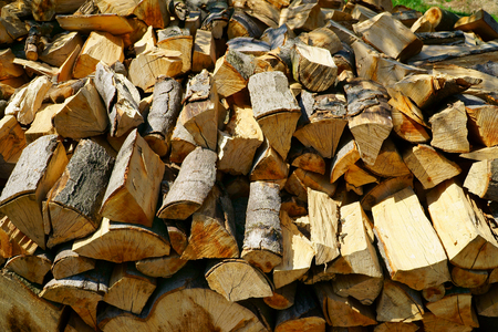 firewood: Background of dry firewood logs in a pile Stock Photo
