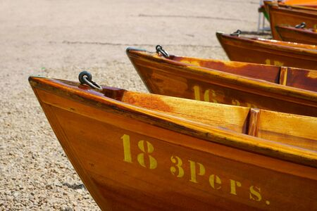 fine wood: View over the prow of rowing boats on the shore of Lake Titisee Editorial