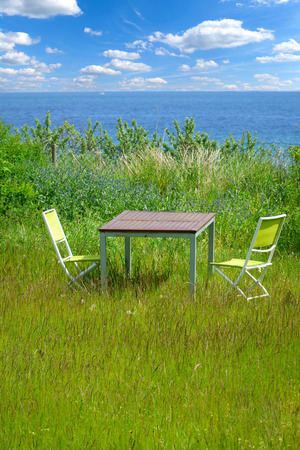 garden furniture: Garden furniture on green lawn with views of the Baltic Sea