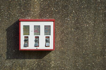 automat: Three Chewing gum machines on an old house wall Stock Photo