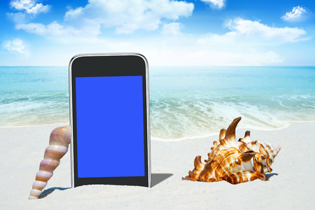 sea waves: Black Smartphone with empty screen display and Seashells on the Beach Stock Photo